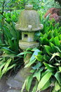 Japanese Statue in a Garden Royalty Free Stock Photos