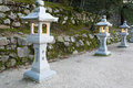 Japanese stone lantern carved in itsukushima shrine miyajima island hiroshima japan Stock Photo