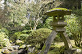 Japanese Stone Lantern by the Creek Royalty Free Stock Photography