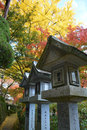 Japanese Stone Lanterns with Colourful Maple Trees Royalty Free Stock Photo