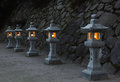 Japanese stone lanterns in the evening Royalty Free Stock Photo