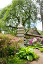 Japanese stone statue and old tea house garden the shofuso Stock Photography