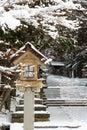 Japanese stone and wooden lantern with snow at Hida-sannogu Hie-Jinja shrine in winter season . At Gifu , Hida Takayama , Japan Royalty Free Stock Photo