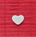 Japanese style love heart on red bamboo mat Royalty Free Stock Photo