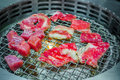 Japanese style Raw fresh beef on hot barbecue grill . Royalty Free Stock Photo