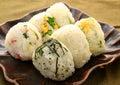 Japanese style of rice onigiri on black platter
