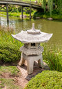 Japanese style stone lantern in the Japanese Garden. Royalty Free Stock Photo