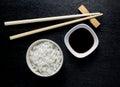 Japanese sushi chopsticks over soy sauce bowl Royalty Free Stock Photo