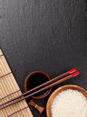 Japanese sushi chopsticks over soy sauce bowl and rice Royalty Free Stock Photo