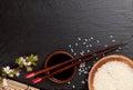 Japanese sushi chopsticks over soy sauce bowl, rice and sakura b Royalty Free Stock Photo