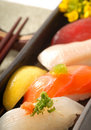 Japanese sushi nigiri with lemon and chop sticks Stock Images