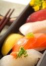 Japanese sushi nigiri with lemon and chop sticks