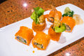 Japanese  Sushi rolls with fresh raw salmon on white plate . Royalty Free Stock Photo