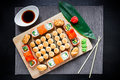 Japanese sushi rolls, soy sauce, ginger and chopsticks on a dark table. Top view. Flat lay. Japanese traditional food Royalty Free Stock Photo