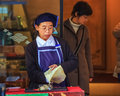Japanese sweet shopkeeper nara japan november in nara japan on november unidentified female shop keeper wraps her with paper for Royalty Free Stock Images