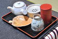 Japanese tea set on wooden tray in the table Stock Image