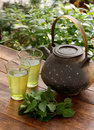 Japanese teapot and green herbal tea Royalty Free Stock Photo
