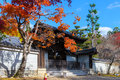 Japanese temple in autumn with colored leaves Stock Image