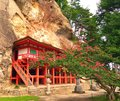 Japanese temple built into cliff face Royalty Free Stock Photo