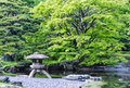 Japanese traditional stone lantern in a park in tokyo Royalty Free Stock Photo