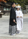 Japanese traditional wedding couple getting married at yakasa shinto shrine Royalty Free Stock Photo