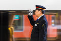 Japanese train conductor osaka japan november in osaka japan on november unidentified gives a hand sign to a Stock Image