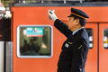 Japanese train conductor osaka japan november in osaka japan on november unidentified gives a hand sign to a Stock Photography
