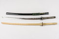 Japanese training swords for iaido and kendo, steel and wood. Royalty Free Stock Photo