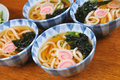 Japanese udon noodles the four bowl of with seafood Stock Photo