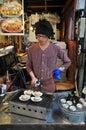 image photo : Japanese vendor fries clam scallop