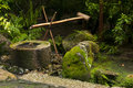 Japanese water bamboo fountain with moss Royalty Free Stock Photos