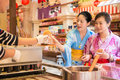 Japanese woman buying pancake Royalty Free Stock Photo