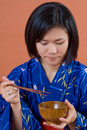 Japanese woman with chopsticks Royalty Free Stock Images