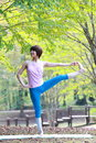 Japanese Woman Doing YOGA Extended Hand-To-Big-Toe Pose Royalty Free Stock Photo