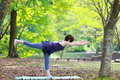 Japanese Woman Doing YOGA warrior III pose Royalty Free Stock Photo