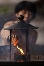 Japanese woman igniting incense nara japan november a is an stick before praying at the todai ji temple in nara near kyoto shallow Royalty Free Stock Photos