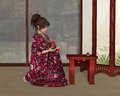 Japanese woman inside her house young wearing a red kimono patterned with flowers holding a saki jug and cup with rain pouring Royalty Free Stock Photos