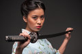 Japanese woman with katana Royalty Free Stock Photo