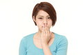 Japanese woman making the speak no evil gesture Royalty Free Stock Photo