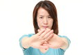 Japanese woman making stop gesture Royalty Free Stock Photo