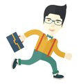 Japanese Worker with briefcase is running Royalty Free Stock Photo