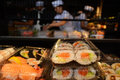 Japanese workers prepare Sushi rolls Royalty Free Stock Photo