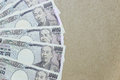 Japanese yen on brown paper background Royalty Free Stock Photo