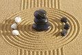 Japanese zen garden with feng shui in sand stones of yin yang Stock Photo