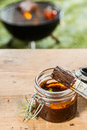 Jar of basting sauce for the meat on the BBQ Royalty Free Stock Photo