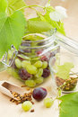 Jar with canned grapes Royalty Free Stock Photo