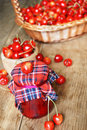 Jar with cherries on the wooden table fresh Stock Photos