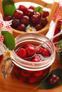 Jar of cherry compote Royalty Free Stock Image