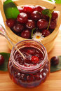 Jar of cherry confiture Royalty Free Stock Photography