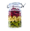 Jar of  coloured pasta isolated Stock Photography